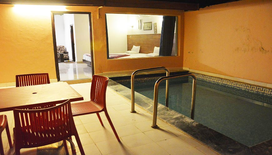 cheap resort room swimming pool in jim corbett